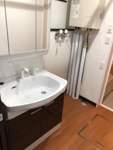 ユーティリティ  洗面台とバスルームのカラーも合っていて統一感がありますね