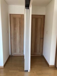 洋室  2階洋室 間仕切りを開けると1部屋に。